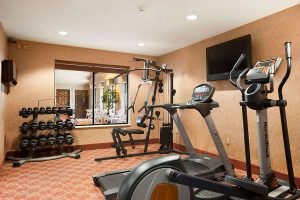 fitness center with weight rack and cardio machines at Ramada by Wyndham Wisconsin Dells