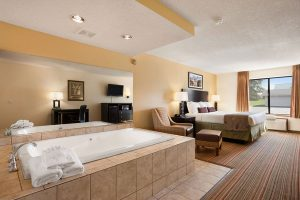 suite with king bed and jucuzzi tub at Ramada by Wyndham Wisconsin Dells