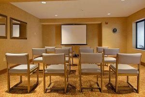 meeting room set up for a presentation at Ramada by Wyndham Wisconsin Dells