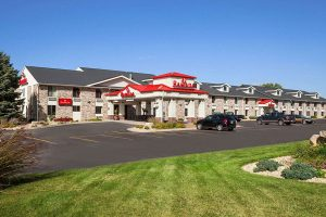exterior building and parking lot of Ramada by Wyndham Wisconsin Dells