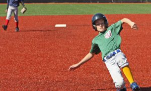 woodside sports team baseball game. player sliding onto base